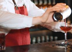 Bartender making Jack Rose Cocktail
